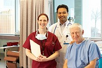 Doctor, nurse and male patient smiling