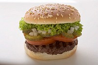 Hamburger with tomato, gherkin, onion and lettuce