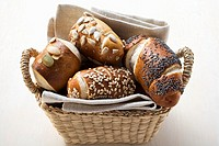 Assorted pretzel rolls or lye rolls in bread basket