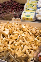 Fresh chanterelles in a crate at a market