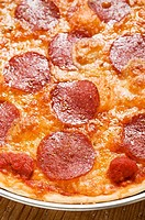 Pepperoni pizza on plate detail