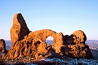 Turret Arch awash in warm early morning light on a crisp winter morning, Arches National Park, Utah, USA