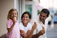 Family eating ice cream cones together