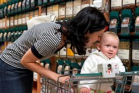 Mother with daughter 9-12 months in supermarket
