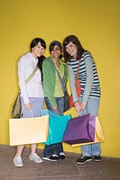 Three teen females with shopping bags