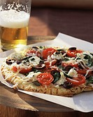 Vegetarian pizza and half pint of beer