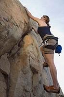 Woman Climbing Rocks