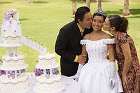 Family near cake at quinceanera