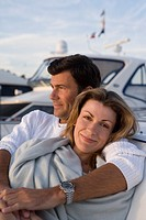 Woman snuggling with man on yacht