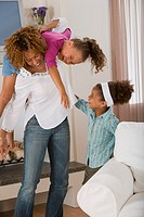 Mother playing with daughters