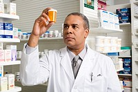 Pharmacist looking at a pill bottle