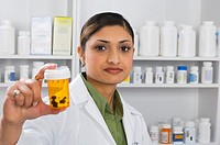 Pharmacist holding a pill bottle