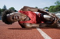 Track athlete on ground in pain