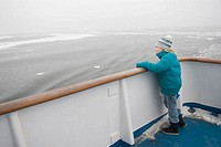 Girl at ferryboat deck in the winter. Åland Islands. Finland