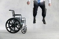 Man jumping next to wheelchair