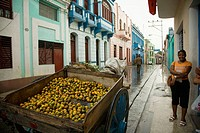 Selling lemons in Heredia street after the rain. Santiago de Cuba. Cuba