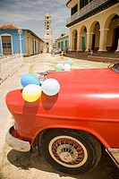 Decorated car for a 'quinci&#241;era' celebration. Plaza Mayor. Museum of the fight against bandits (Museo Nacional de la Lucha Contra Bandidos) in former ...