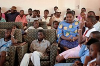 Chidren listen to a speech about self respect during a staff Christmas party at the Howard Hospital in Zimbabwe. The children aged 10 and up to late t...