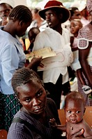 A mother and child wait to be seen by a nurse on National Child's Day at the Howard Hospital in Zimbabwe. The week long event features weigh_ins, shot...