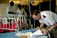 Dr. Paul Thistle, Chief Medical Officer, Howard Hospital, Zimbabwe, does his rounds in the male ward. Thistle has been with the Hospital for twelve ye...