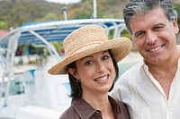 Couple smiling by yacht