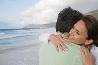 Couple hugging on beach