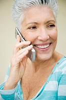A senior woman using a mobile phone
