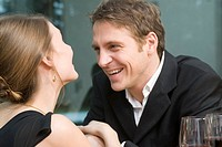 Couple in love laughing happily