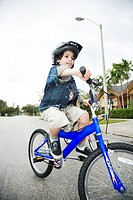 A young boy on a bike
