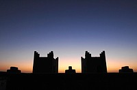Silhouette of buildings at dusk