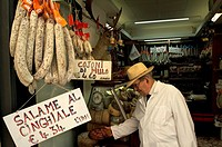 Side profile of a senior man working in a store, Castiglione Del lago, Umbria, Italy