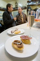 Tapas (anchovies, spiced sausage) and cava (Catalan sparkling wine), El Xampanyet bar, Barcelona, Spain