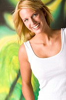 Blond woman in white shirt with happy smile