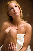 Blonde woman wrapped in white bath towel