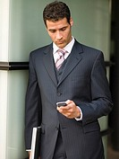 A businessman looking at his mobilephone