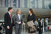 Three business people standing at the airport