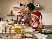 Father baking cookies with his children