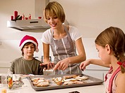 Mother baking cookies with her children (thumbnail)