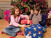 Siblings opening their Christmas presents (thumbnail)