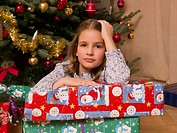 A girl sitting with her Christmas present