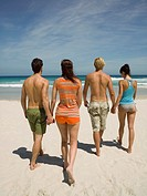 Couples walking on the beach