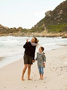 Mother and daughter collecting sea shells on the beach (thumbnail)