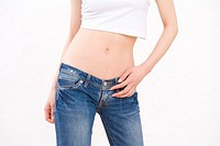 Woman wearing jeans, front view