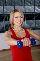 Woman doing weight training in gym