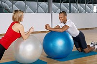 People stretching on the fitness ball