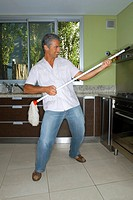 Man playing air guitar with mop