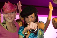 Close-up of two young women singing in a nightclub