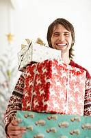 Young Man Holding Christmas Presents