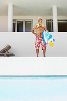 Man Standing by Pool (thumbnail)