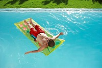 Boy on Raft in Swimming Pool